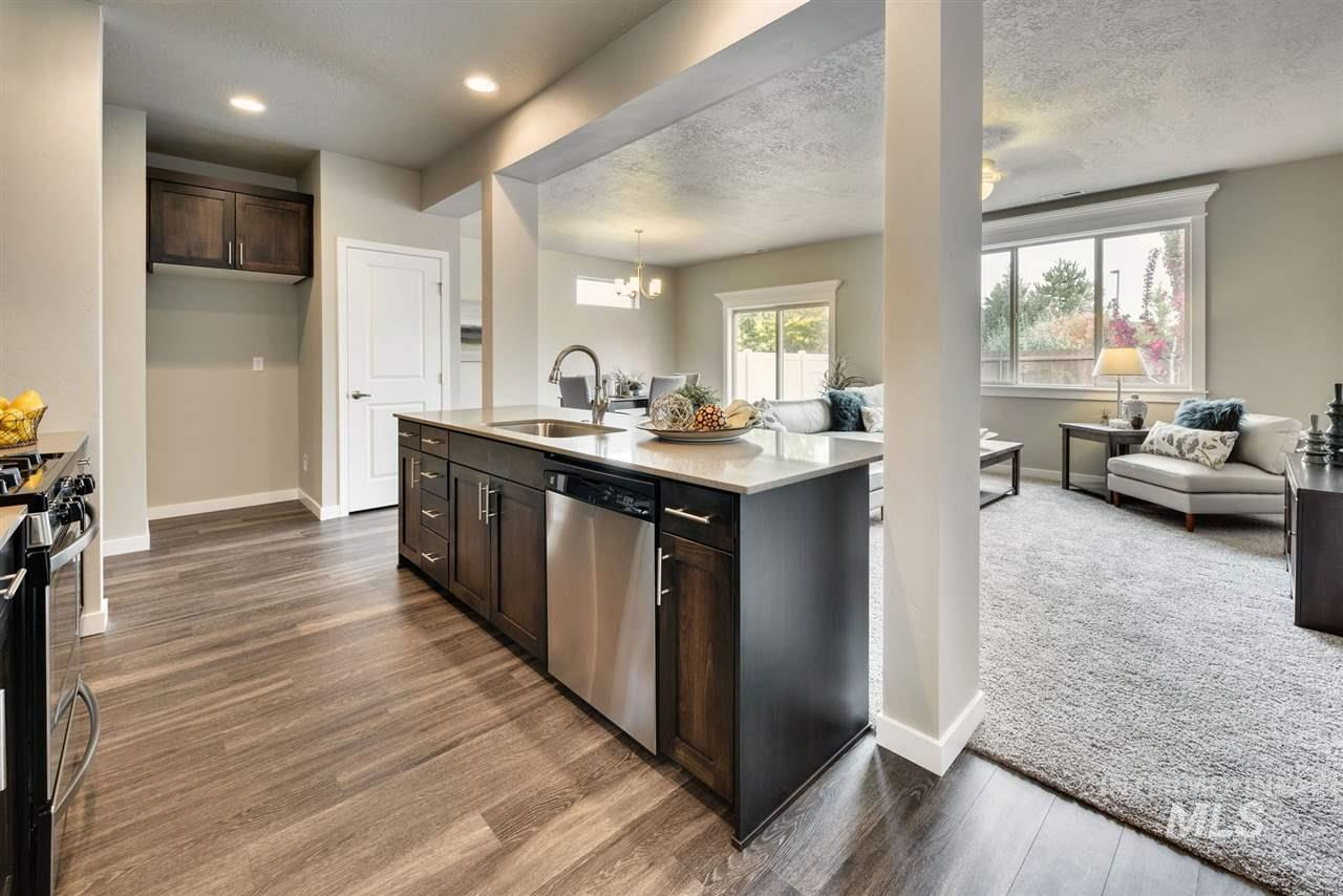 Mesa | Blackrock Homes. It's more then just a house, it's a neighborhood. See how spacious this layout really is. Entertaining is better w/ this expanded galley kitchen highlighted by a large island overlooking the great room. Custom kitchen cabinets! Thoughtful outerwear niche, discreet powder room & more. Pics and Tour similar. LANDSCAPE MAINTAINED BY HOA, NO MOWING!!