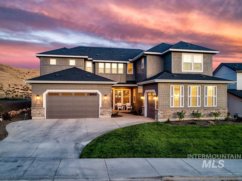 Multi-generational home captures inspiring views of East Boise's rolling foothills. Less than a year old, this home lives comfortably with its open entertaining areas & tucked away spaces for privacy. Upon entry, guests are greeted by the stunning vistas framed by a wall of windows & inviting grand staircase. Wood floors span throughout the main-level, providing a seamless flow for entertaining into the graciously sized kitchen. Fully equipped w/Electrolux double ovens, gas cooktop, fridge, washer, & dryer.