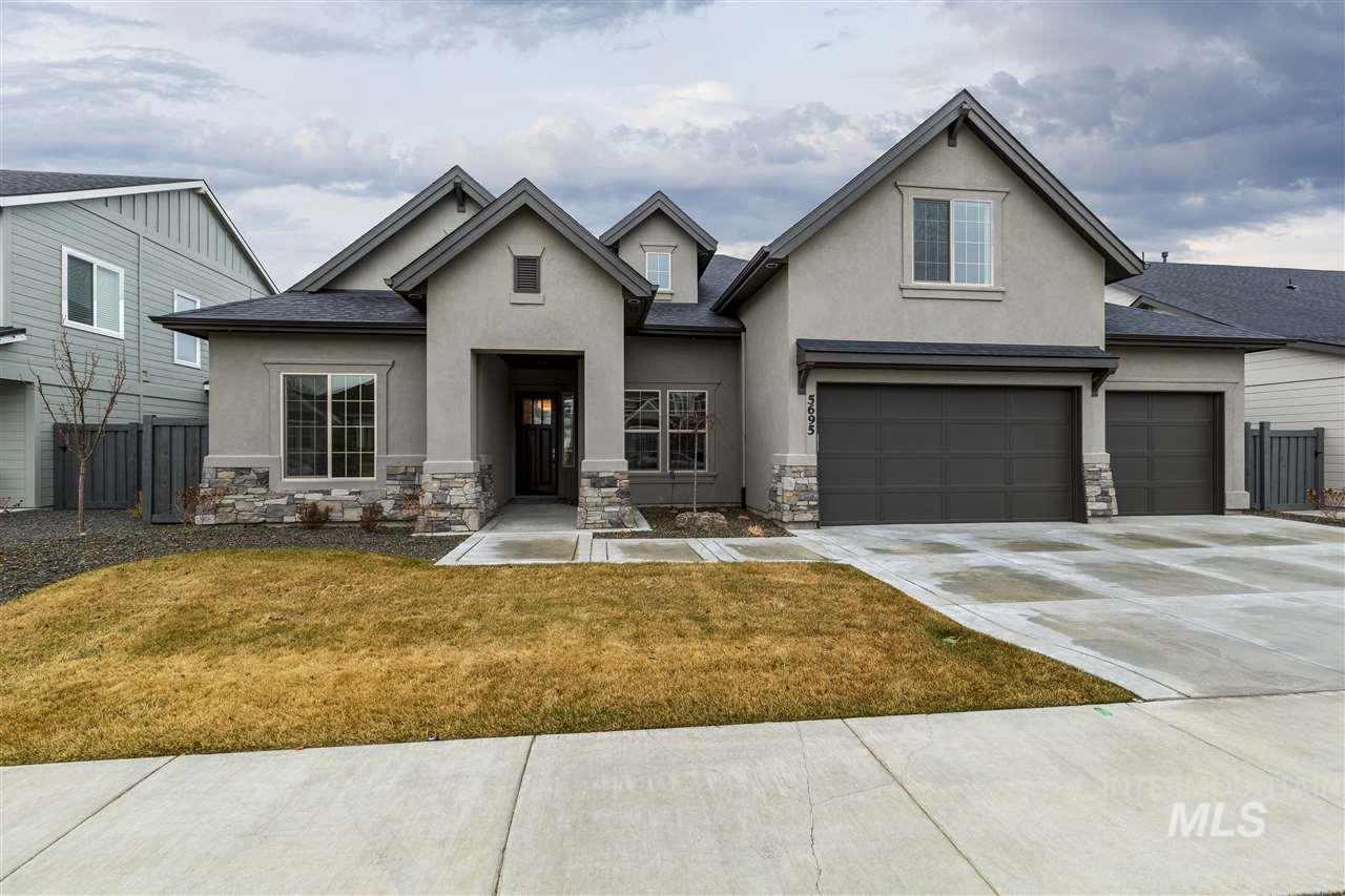 """PHOTOS SIMILAR The """"Garrik Joseph"""" by James Clyde Homes. All the bells and whistles you've come to expect from James Clyde: Extensive hardwood, amazing stainless steel Thermador appliances, custom built cabinetry, breathtaking trim work & detail that only a true craftsman can deliver! Secret Room and Bonus Room upstairs. Check out the over sized 4 garage! Full landscaping front & back! Price includes full fencing! BTVAI"""