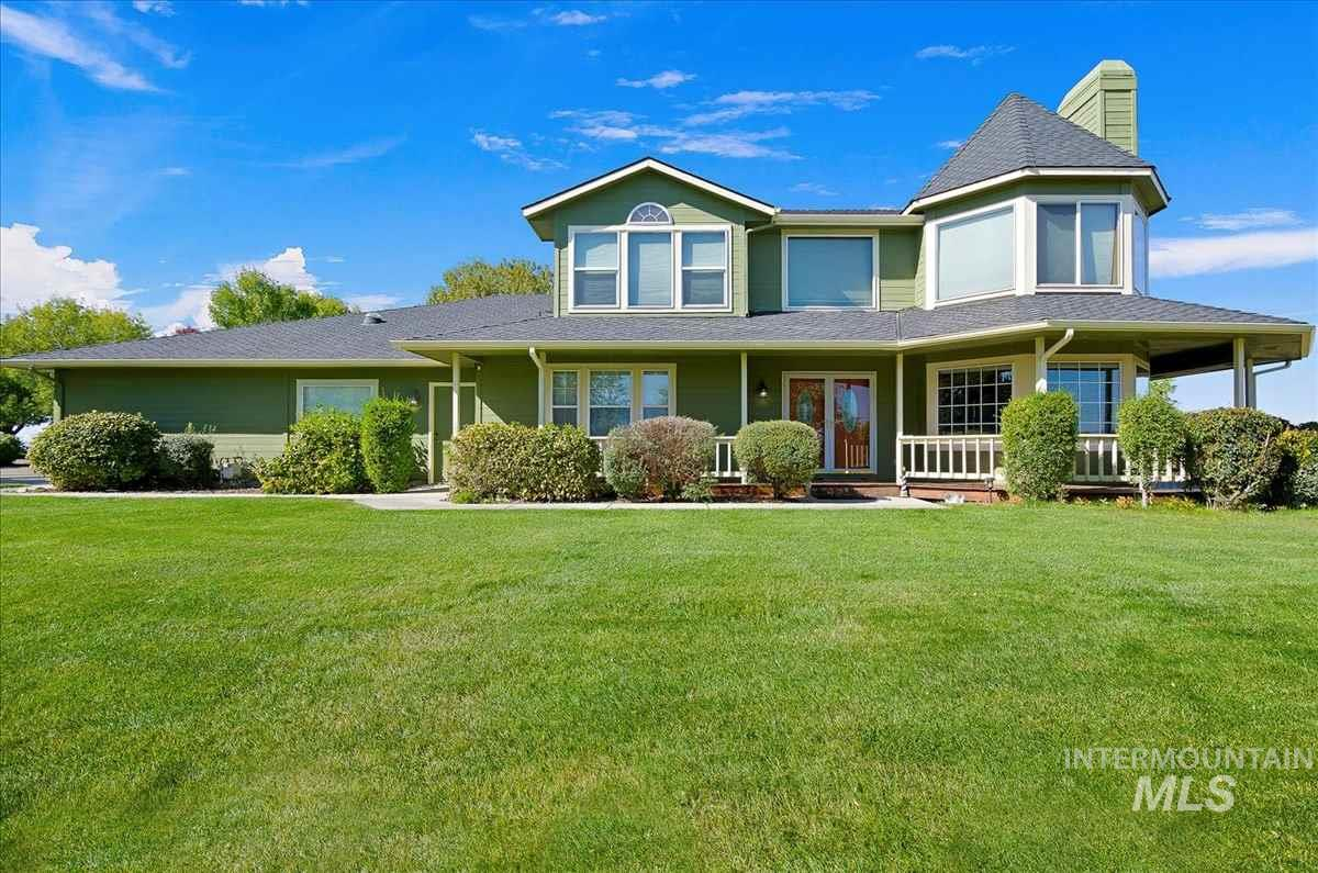 Rare, extremely private, spectacular estate property close to the city. Gorgeous custom 5BD/2.5BA home on 5 acres with an equally fabulous 1200 SF 2BD/1BA guest house above a detached 3-car garage/shop with 1/2 bath. Acreage can be split into 2 parcels - home on 2.5 acres & 2.5 acres vacant land developable view-lot. Features beautiful rim views, wrap-around porch, multiple office spaces, flex rooms, bonus room, gourmet chef's kitchen, 2 fireplaces & park-like grounds. Truly an entertainers paradise!