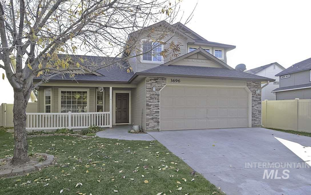 No Cookie Cutter Home Here. Inside is a great room with vaulted ceilings,bay windows and pergo dark wood floors. The large main floor master has a walkin closet. Upstairs are 2 bedrooms, a computer area and a spacious family room that could be made into a 4th bedroom. The patio has an arch cover with retractable sides. The back yard has lot's of flowers and a decorated garden area with raised flower beds & fruit trees. No neighbors behind just a beautiful common area adding to the uniqueness of this home.