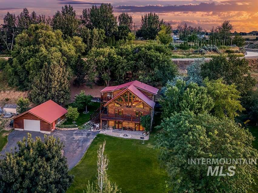 1st time on market, this single owner log home was lovingly handcrafted. No detail was spared as each log was hand scraped. Two story hurricane windows sweeping the home allow dramatic views of mountains & flood the home w/abundant natural light. This retreat sits on .91 acres, serenely landscaped w/fruit trees & 2 private decks to enjoy the privacy of no back neighbors or CCRs. Oversized 900 sq ft garage w/loft, new A/C & furnace. Easy access to interstate & avoids Eagle traffic. Contingent offers welcome.