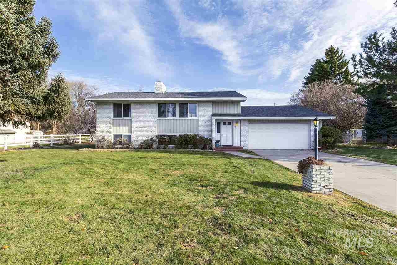 No HOA, No CCR's! With all the amenities of the city but with a country feel this beautiful split entry 1976 sqft 4bed/2bath home on .72 of an acre in Nampa is ready for its new owners. With 2 fireplaces, a covered deck, brand new carpet and paint this home is move in ready. With a lot of garden space, fruit tree's and a huge rear area for whatever your heart desires the outdoors could be the retreat for anyone with a green thumb.