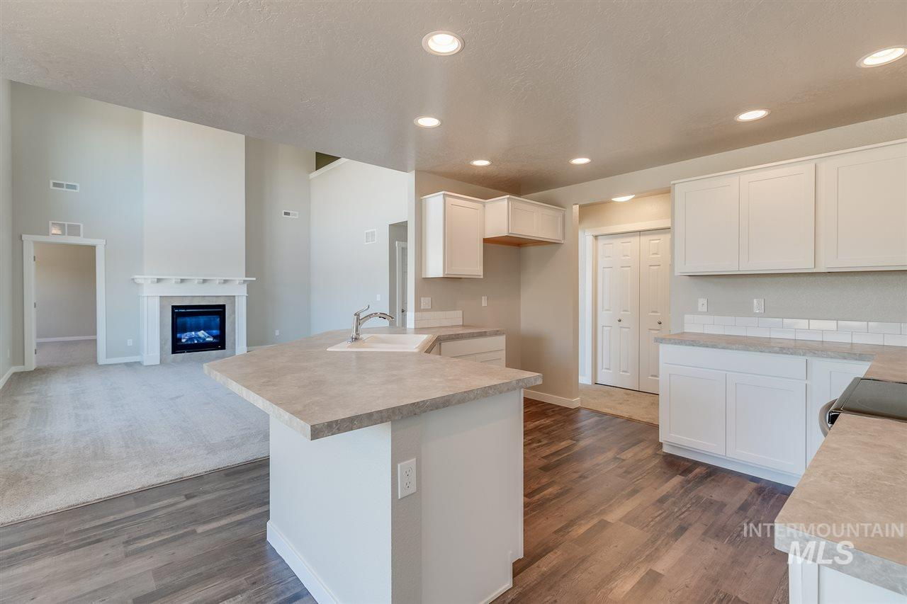 Get $15k with the Festival of Homes Promo NOW thru 12/31. Floor to ceiling windows set the stage for your next entertaining space. Upstairs you'll find 4 bedrooms and enclosed bonus room. Cat walk opens to below and keeps the grand theme going. Master w/ large closet, bathroom with shower and soaker tub. RCE-923.