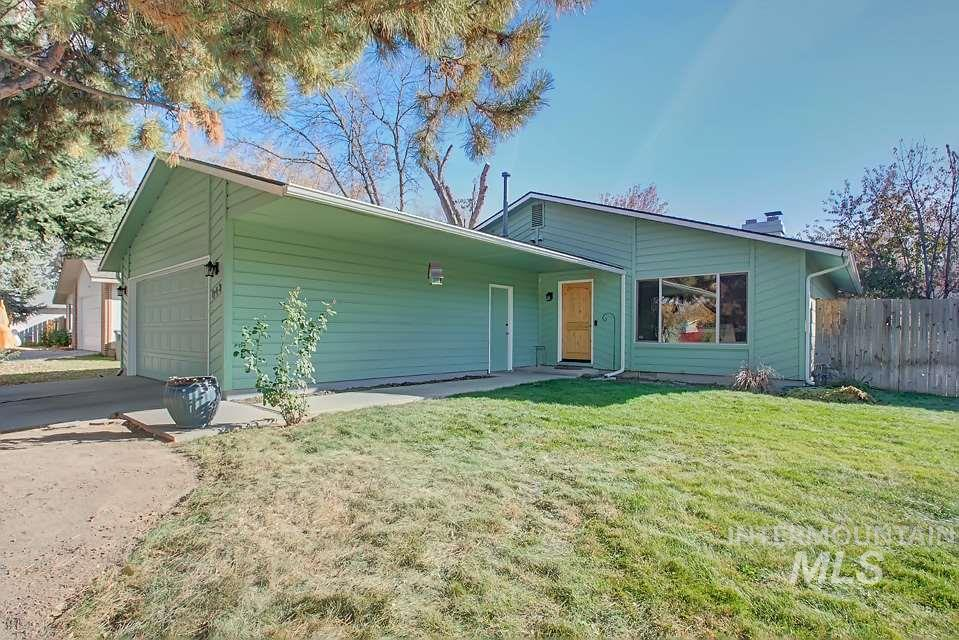 This perfect, immaculately kept home will impress you from the second you walk in the door! This prime location in SE Boise is perfect with NO HOA's! Enjoy the large vaulted ceiling in the living room w/a wood fireplace, perfect for the holiday season. New high-quality hardwood flooring throughout the entire home. Both bathrooms have been completely upgraded with beautiful ceramic tile and vanities. Spend summers under a covered patio in a fully fenced yard w/a large garden area. Be ready to be impressed!