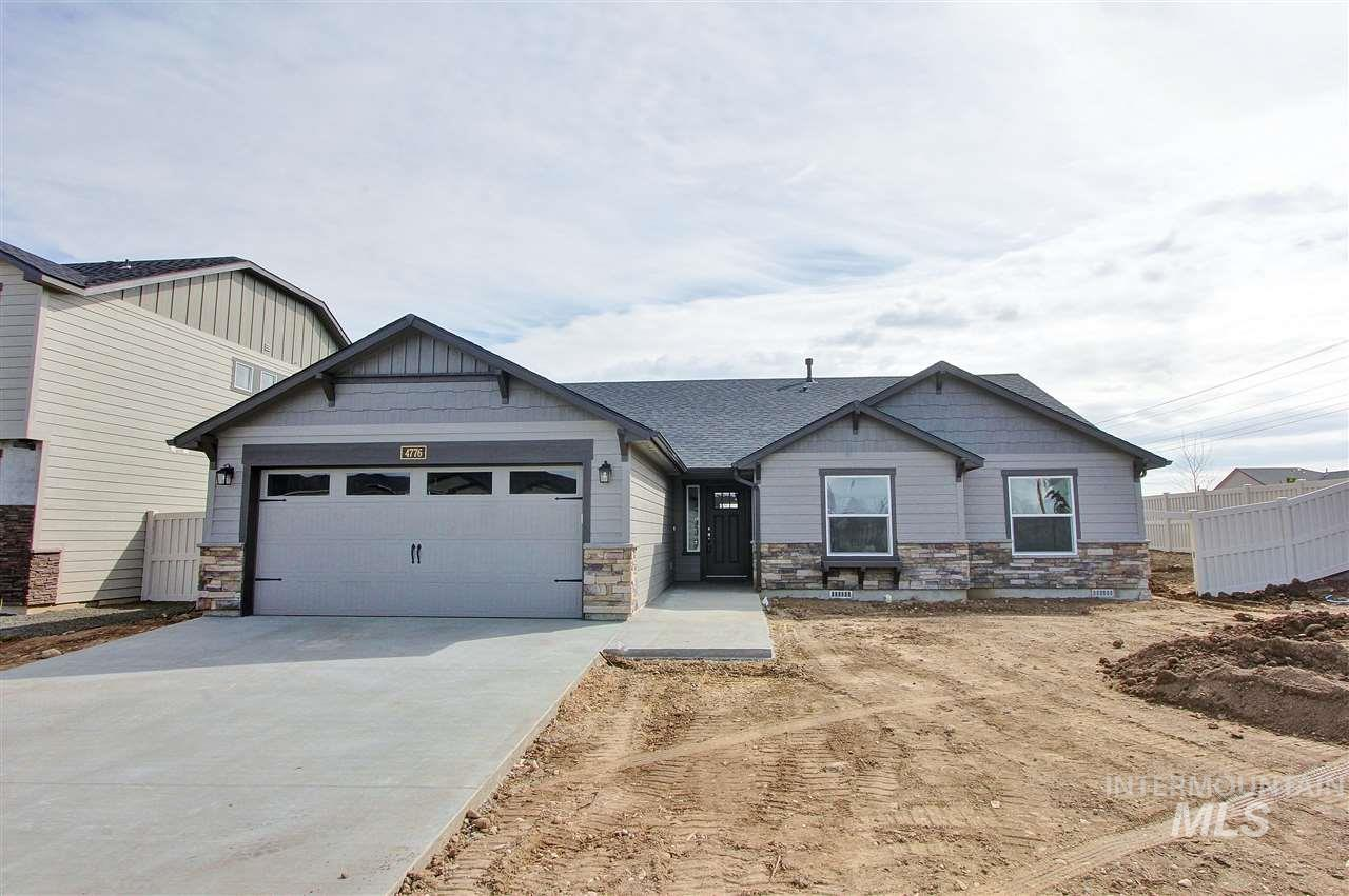 """**NEW!** The 1805 square foot """"Pacific"""" is an open floor plan home with vaulted ceilings, living room with fireplace, covered back patio with gorgeous mountain views. Quartz white countertops with upgraded painted gray cabinets as well as built in desk."""
