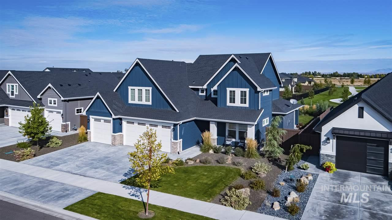 Stunning BainBridge home on the Park. Featuring double master suites, open layout, stainless steel appliances with double ovens, huge panty, large bonus room with upgrades galore. Community features include two pools, open areas, and a 7 acre park. Welcome home to BainBridge!
