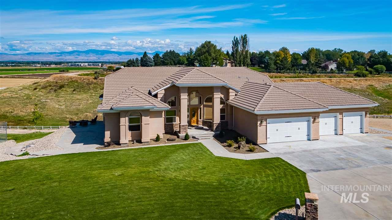 Panoramic Views of the Treasure Valley and Bogus Basin mountains! Stunning home sitting on just over 3 acres of usable land, bring your horses, park your toys, or build your shop. Custom cabinets, granite, corian, fire sprinklers, central vac, huge deck, all rooms oversized! Entertainment possibilities are endless, with a tennis court, theatre room, wet bar, and massive open living room.