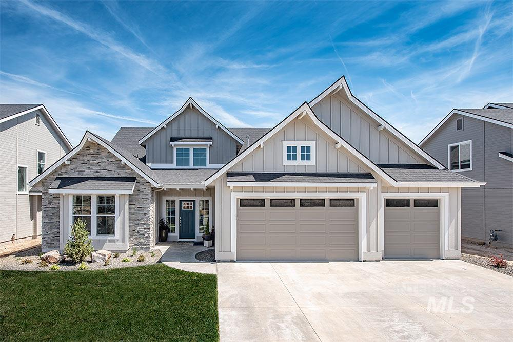The 'Bitterroot' by Eaglewood Homes. Meticulous craftsmanship in this home includes detailed tile finishes, beautiful granite  counter tops, and custom-made cabinetry throughout the kitchen and bathrooms. Large master suite on main level with  vaulted ceilings, full tile shower, soaker tub, and walk-in closet. Additional bonus room upstairs. Covered patio. Giant 3 car garage. Full front and back landscaping and fencing. Photos Similar
