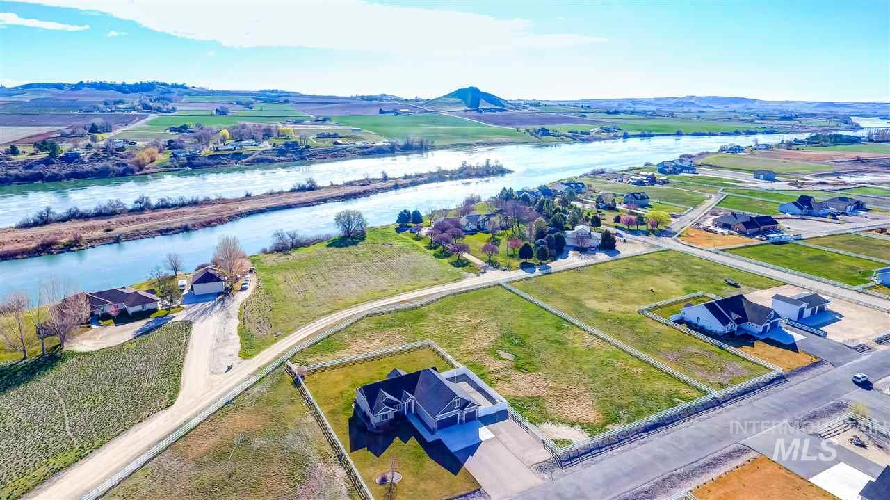 Rare 2 acre estate in the heart of wine country, only steps away from the Snake River. Spectacular views of Owyhee Mts & Lizard Butte w/direct access to river w/water rights. Ideal for animals w/2 pastures, full pressurized sprinkler system on timer, & plenty of room for shop. Spacious 3 car garage w/RV parking behind gates. Open concept w/split bedrooms, office & bonus room, spa like master w/custom tile, & new interior paint & carpet. Just 1.5 miles to boat launch & park, this is Idaho living at its best.