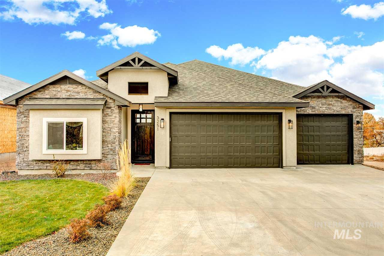 OPEN Sat. 11-3 and Sun. 12-2. Custom build by Affinity Homes of Idaho, this single level on 1/3 acre epitomizes the trending transitional, farmhouse design. Entertainer's great room flooded w/natural light, gleaming hardwoods, charming built-ins & gas fireplace. Kitchen boasts endless quartz counters & cabinetry, stainless appliances & butler's pantry. Spa inspired en suite master bath w/slate flooring, walk-in shower & expansive closet. Versatile layout w/Jack & Jill guest suites, office, & covered patio.