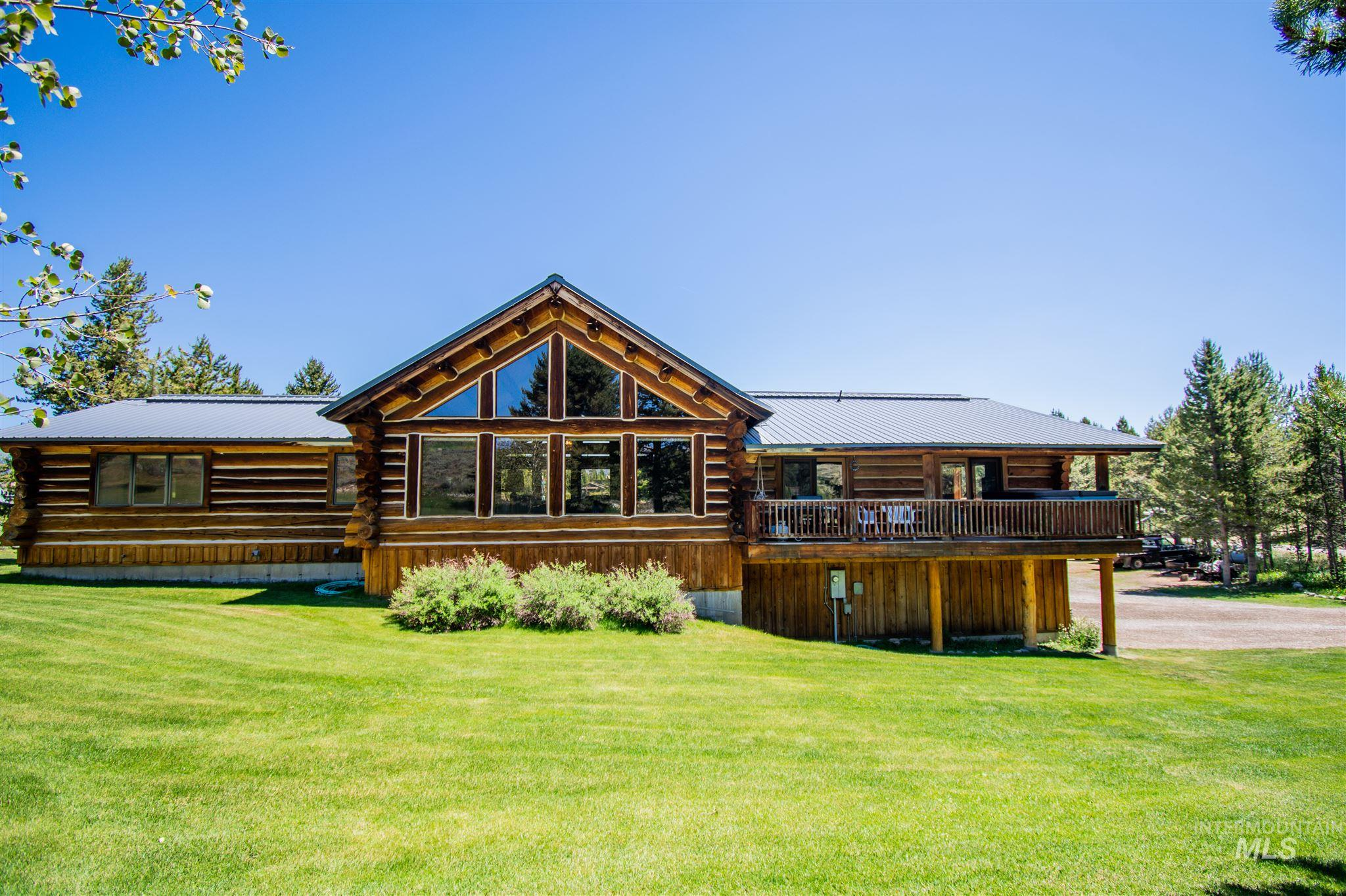 Spectacular log home on just over an acre. Spacious floor plan with 4 Bedrooms 3 Bathrooms. Large deck to relax and enjoy the views of the stunning Sawtooth Mountains. Bring horses and your ATV's. This home is absolutely perfect for summer weekends or snowy winter holidays.