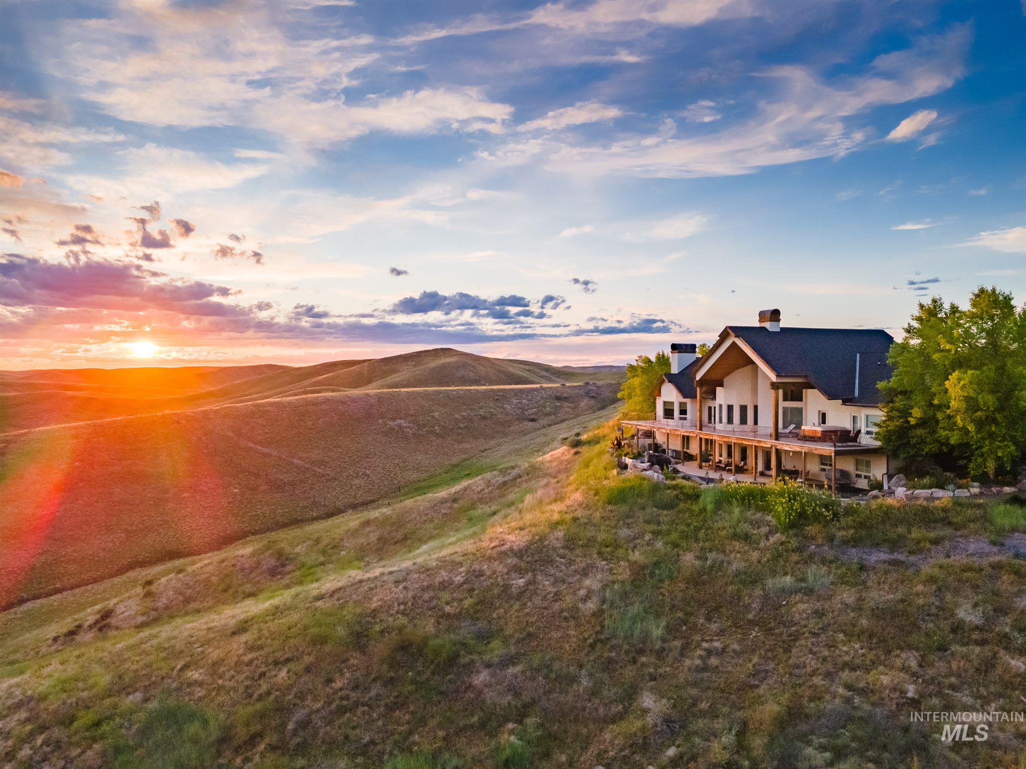 The pinnacle of high living, this palatial 10 acre estate home perched atop the rolling hills of North Eagle boasts the most breathtaking & awe inspiring 360° views of the entire valley. Wrap around balcony spans the entire main level offering unobstructed views from Nampa to Boise as far as the eye can see. Expansive & flexible floor plan, bountiful great room with vaulted ceilings, an entertainer's paradise. This Home exudes charm, with 90 yr old reclaimed barn wood floors there is character in abundance.