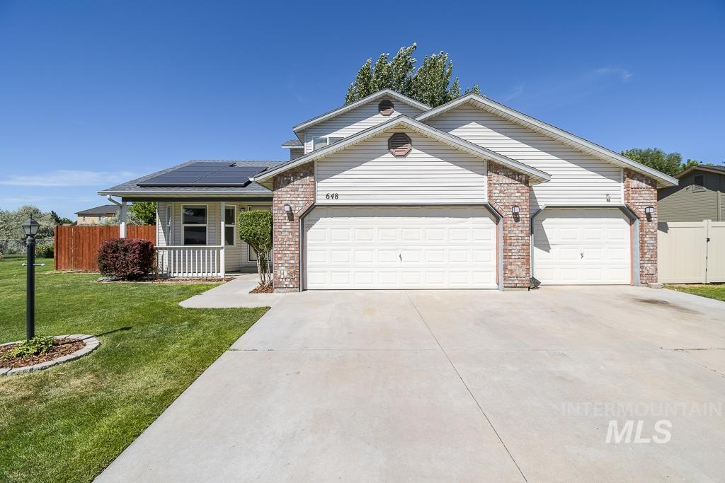Come and see this beautiful 2 story inviting home in a highly desired area! This bright cheery home has so many features like solar panels that provide almost free electricity (go green), new AC unit, 4 bedrooms, new vinyl flooring throughout, a master bedroom with a slider door on to your pergola covered deck in a large size backyard with year round creek nearby and community walking path ways. Inside the 3 car garage there is a built in workshop! Minutes away from amenities, a true must see!