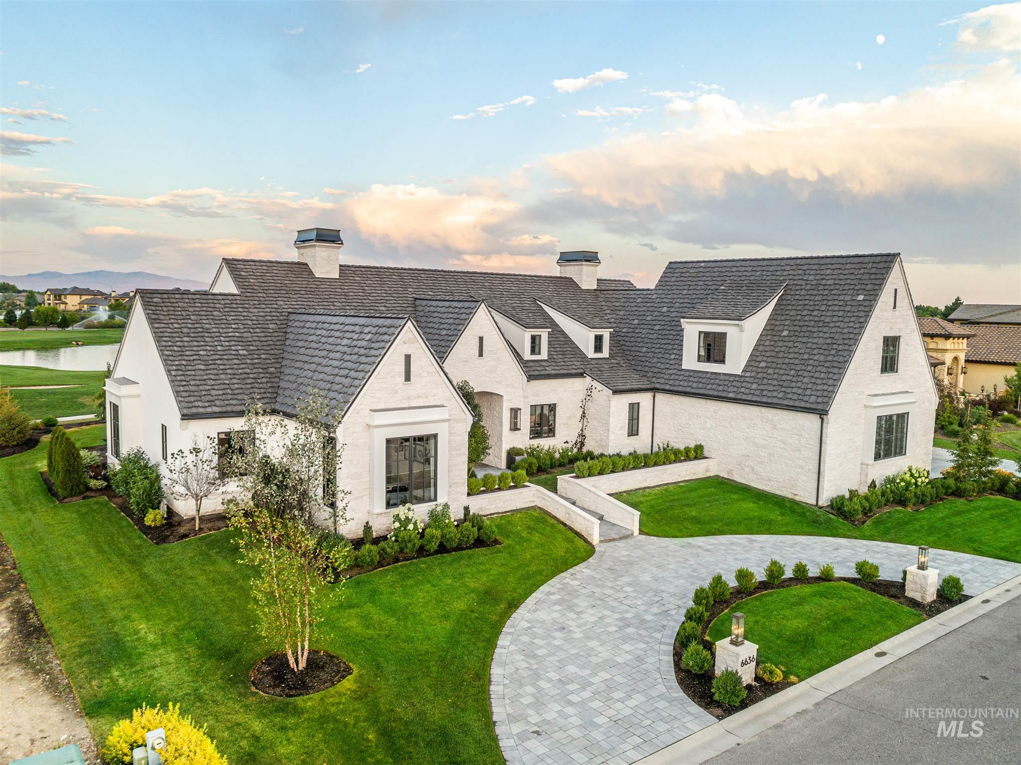 This level of perfection and artistry can only come from the award winning Northern Construction and architect Trey Hoff. Timeless architectural balanced with exquisite craftsmanship that is a step above the rest, prominently poised with relaxing pond views in the very desirable Spurwing Challenge Estates. Features include Crestron home automation, Gas lanterns, Rich wood beams, Stunning hand crafted limestone fireplace, Exquisite top of the line kitchen and bar, Wood fired pizza oven, Walk in Safe & Shop.