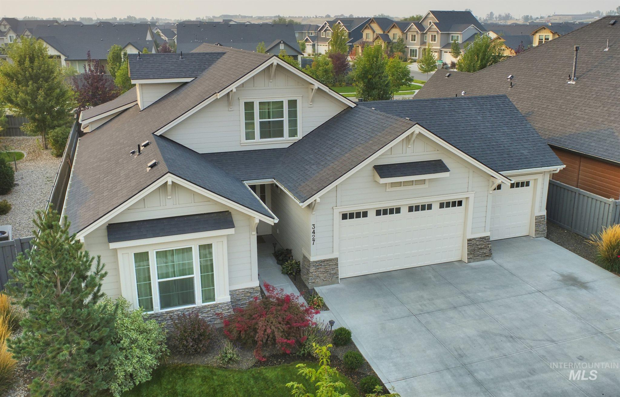 Brighton beauty & quality. This gently lived-in home is thoughtful and spacious. Main level living with an upstairs Bonus room & 3/4 bath, great room built-ins, den, and large covered patio.  Bosch stainless appliances, custom alder stained cabinets and granite counter-tops in the kitchen and master bath.  You'll love the large entry and coffered ceiling detail.  Move right in and enjoy your very private back yard and a great neighborhood. Energy Star Certified home with a HERS rating of 69.