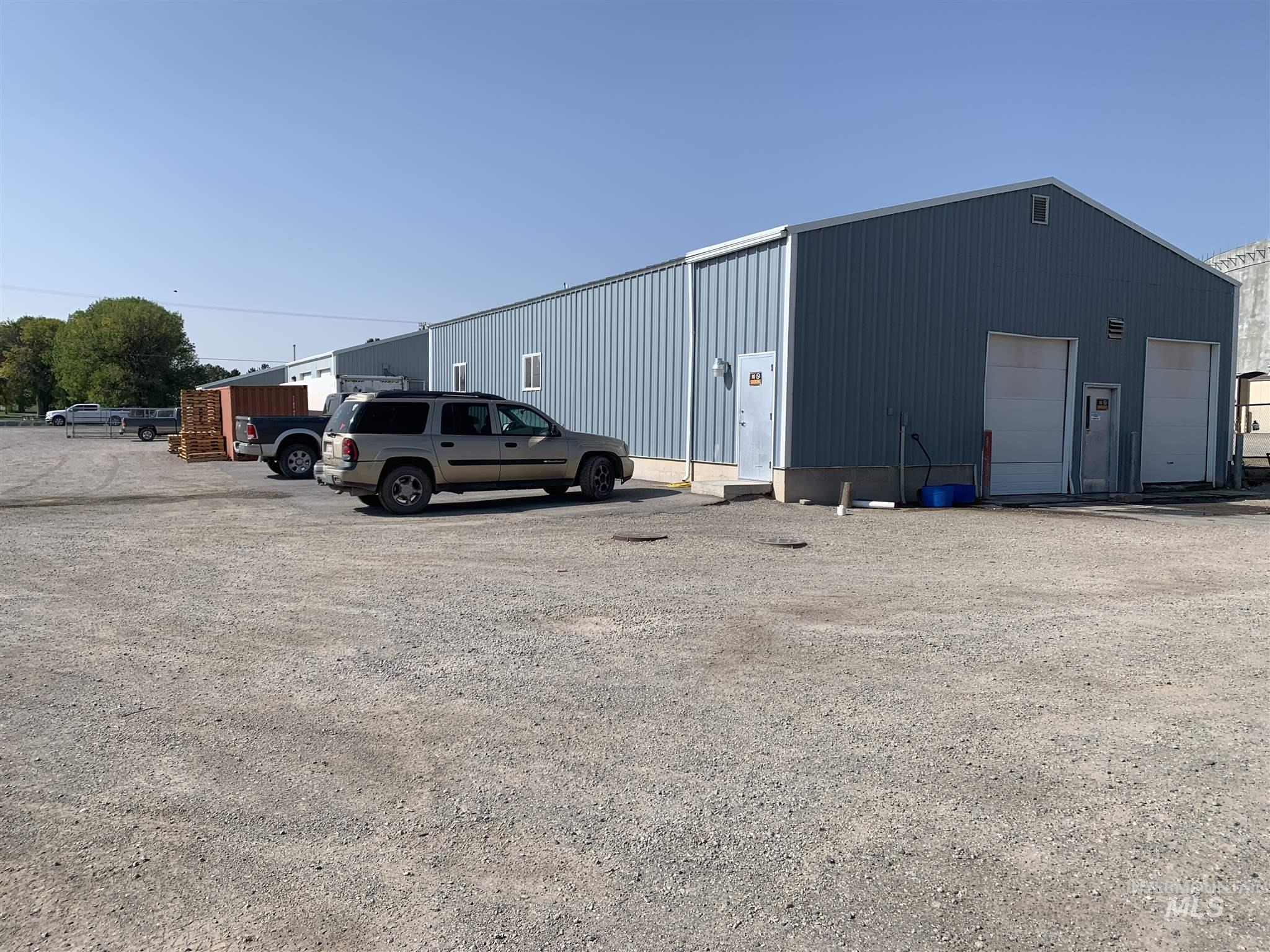 2 acres with 2 each 40' X 60' Buildings with coolers and rails for processing meat.