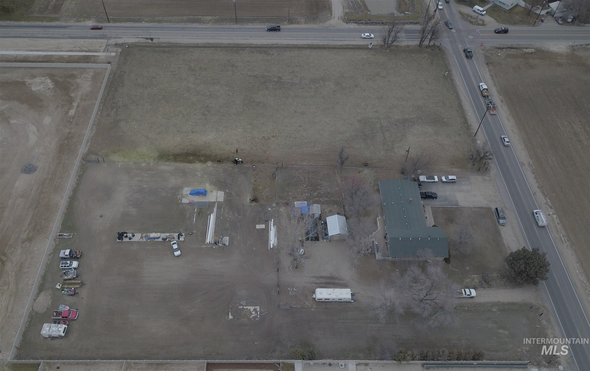 Prime development property at the southwest corner of Ten Mile and Lake Hazel. Value is in the land and potential re-zoning. Property includes a nice 3 bed 2 bath 2030 sq ft home that is currently on its own well & septic. All city services stubbed and ready for hookup. Very busy SW corner lot intersection with easy access to Meridian, Nampa and I-84 Ten Mile Interchange. - Brett Kent, Main: 208-350-1308, 1st Place Realty, LLC, Main: 208-376-2122,