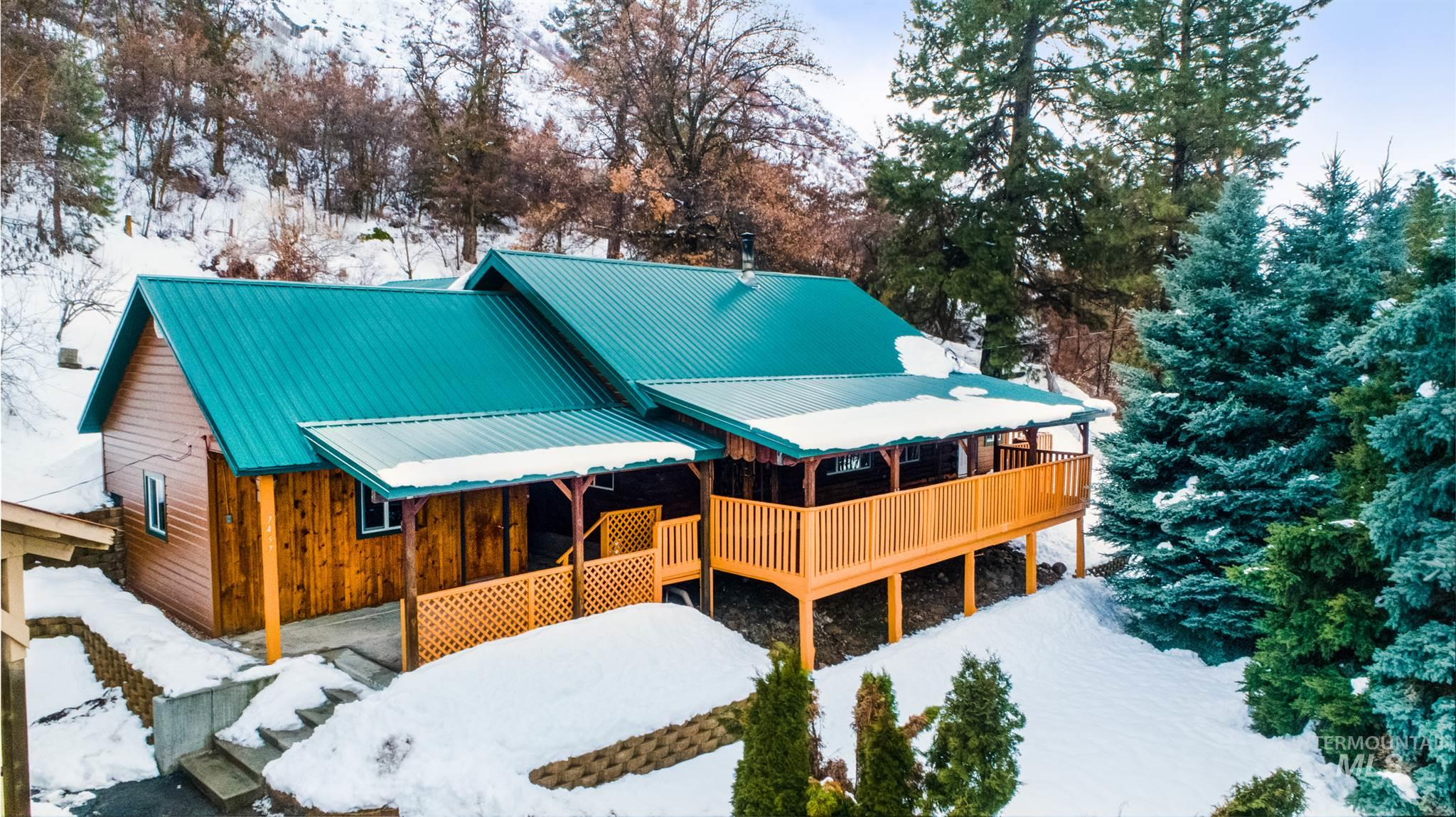 OPEN Sun. 3-5 Iconic log cabin steps from the Payette river, public lands & only 35 minutes from Boise. Sitting on 1.7 acres across from Chief Parrish beach, this remodeled gem is a perfect mountain getaway. Endless outdoor living & toy space w/level backyard, expansive deck, RV garage/carport, attached shop w/power & 3 storage sheds. 2 story tongue & groove ceilings, updated lighting, main level master w/soaker tub, massive guest bedrooms plus flex room, & brand new guest bath w/tiled shower off great room