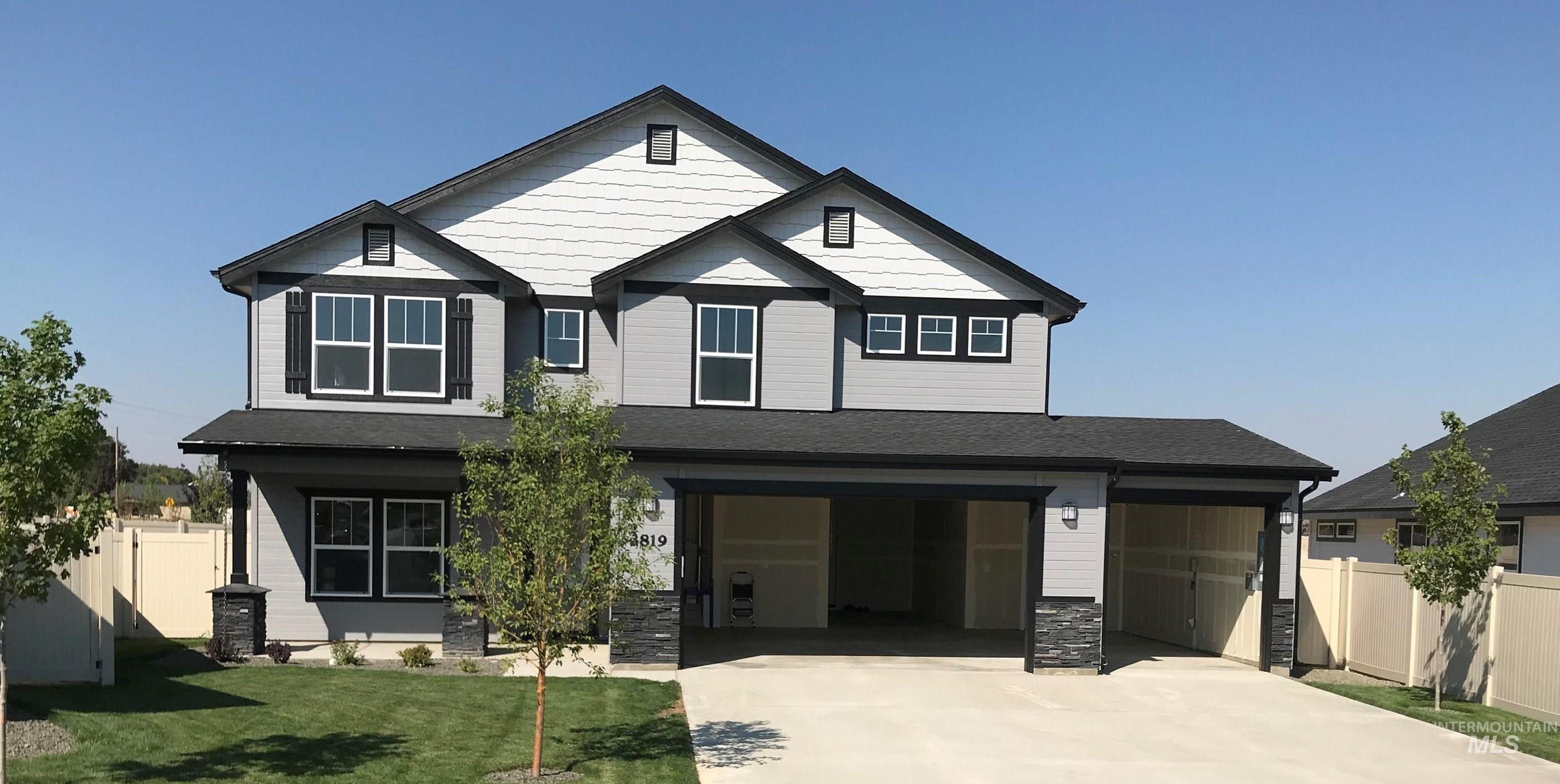 Pre-sold Garnet with Heritage Elevation. Photo Similar. This home features quartz kitchen and bathroom counters, large covered back patio, 9' ceilings, separate tub and shower in master bath, double oven, wood wrapped windows, insulated garage, upgraded cabinets, gas range, and so much more.