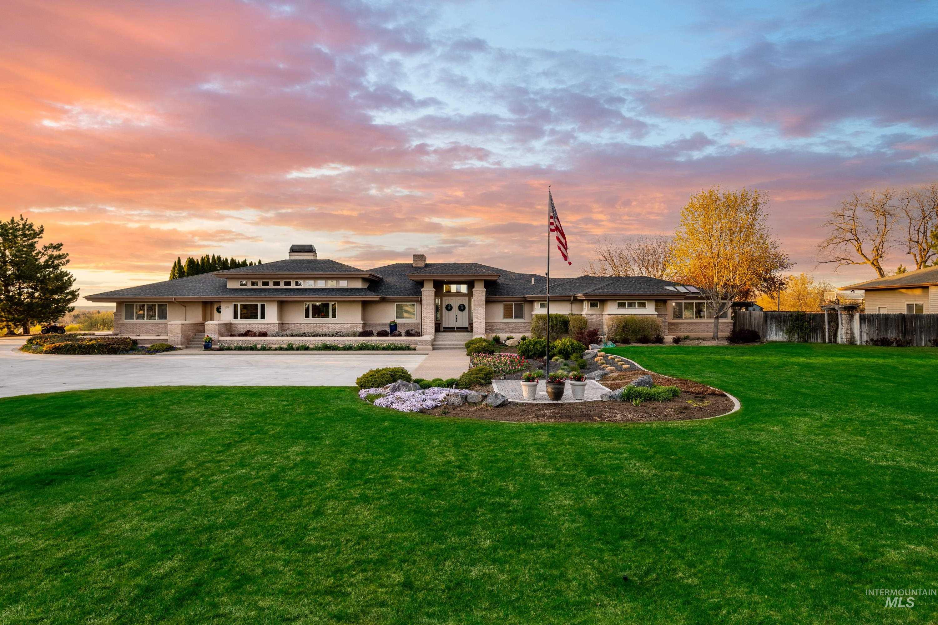 Set on a prime rim lot overlooking the Boise River with views of Squaw Butte, this Trey Hoff designed masterpiece offers nearly 5 acres of space including a detached shop, & a horse barn with riding arena. Wake up to stunning views in the master retreat that features its own sunroom and indoor hot tub. The kitchen features state of the art amenities including Wolf & Thermador appliances, and beautiful granite finishes. The backyard oasis has multiple entertaining spaces and a large pool and sport court.