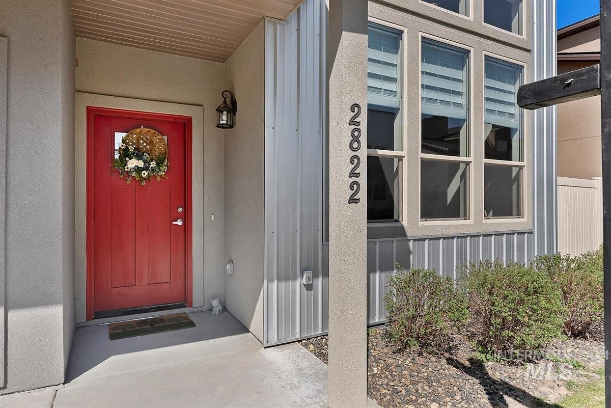 Imagine living in this bright, luxurious and contemporary townhome with 14 foot ceilings in the living area, laminate wood flooring, tile, granite countertops, huge pantry, and fireplace with tile surround. Primary BR on main with walk in closet and dual vanities. Two additional primary BRs upstairs, plus a powder bath on the main. Lots of storage and 2 car garage. HOA covers landscaping, snow removal in common areas. Close to Kleiner Park, shopping, schools, restaurants, The Village, hospital and freeway.