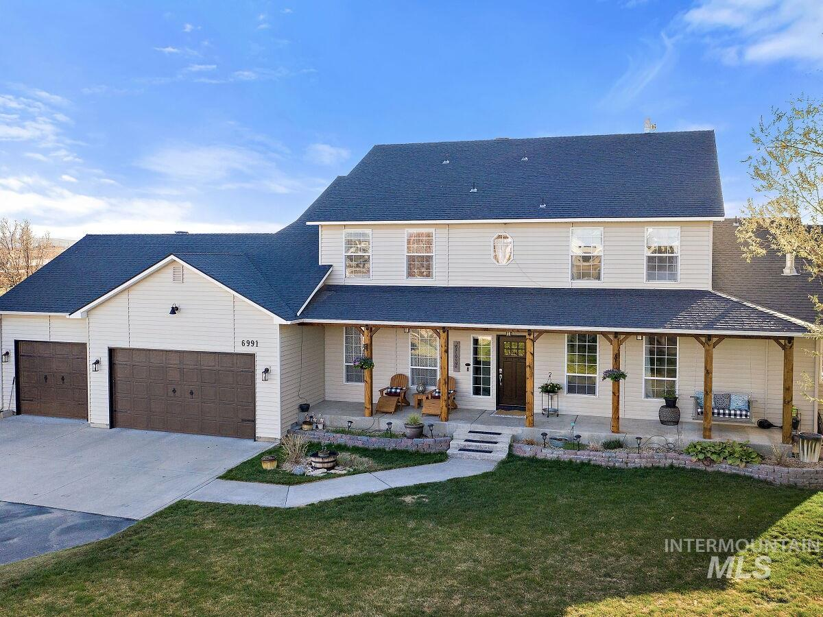 Enjoy stunning views of the Owyhee mountains from the screened patio or hot tub on the back patio.   Private and peaceful ranch living close to everything!  20 minutes to downtown Boise; easy freeway access.  This beautiful farm style, 3,653 sqft. home has been updated throughout. Mature fenced yard, garden boxes, RV pad, RV dump w/30 amp hook.  12 acre farm can produce 3 to 4 cuttings per year of grass/alfalfa blend hay.  Three stall horse barn with upstairs game room. Solar Powered efficiency. - Mindy Plum, Main: 208-631-0426, Silvercreek Realty Group, Main: 208-377-0422,