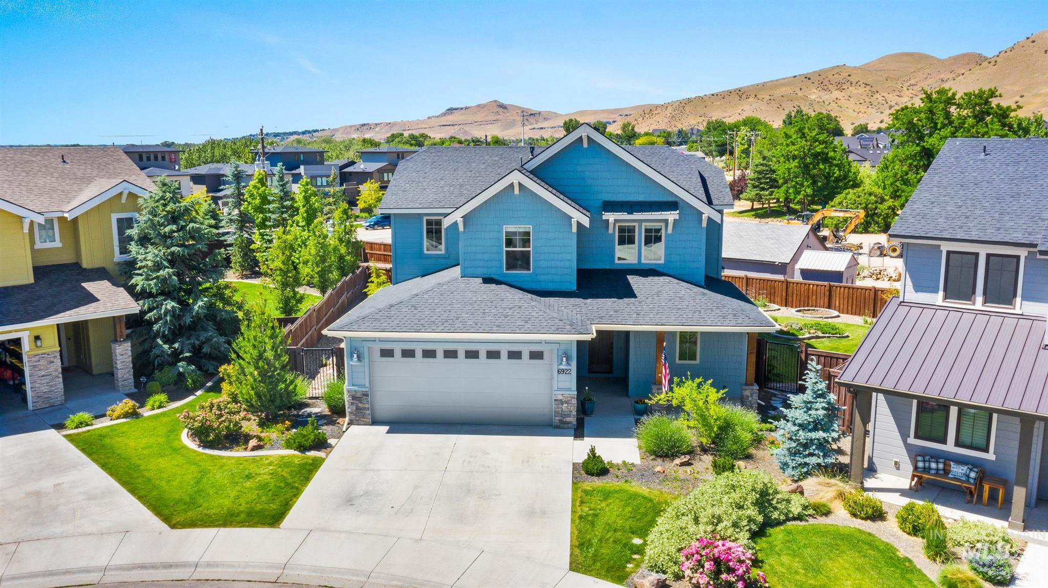 OPEN 6/14 from 11-1 Stunning nearly new home, walking distance to the NE foothills, greenbelt, river, & top ranked schools. Modern lines & designer finishes adorn this cheery home on a .21 lot overlooking the mountains w/stunning sunsets, organic garden beds & covered patio w/no back neighbors. Highly sought after open layout w/guest suite on main level. Dream kitchen features walk-in pantry, wine rack, expansive island & high end appliances. Luxurious master w/custom tiled shower, soaker tub & huge closet.