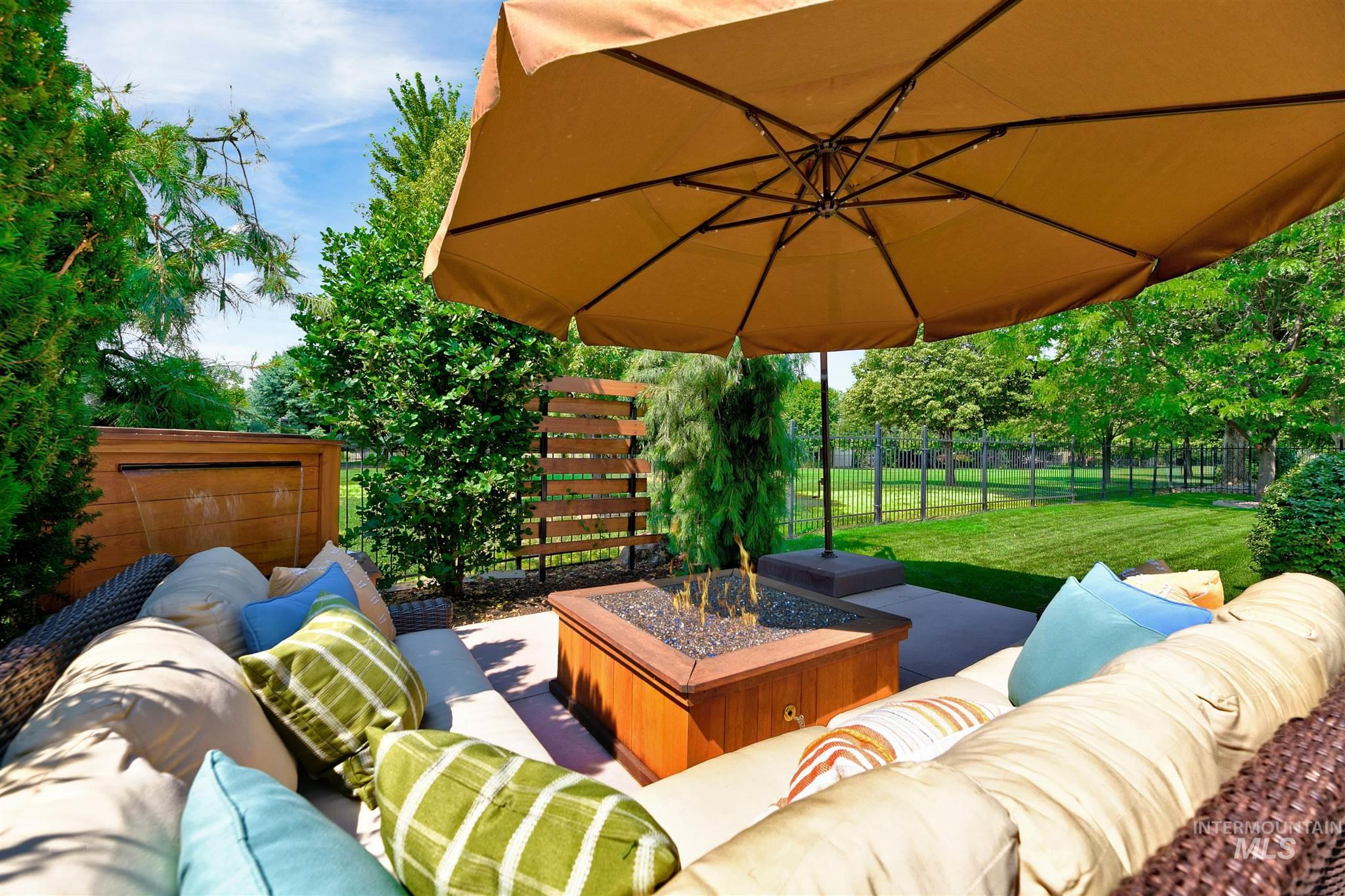 Nestled in the desirable Paramount Community, this stunning home sits on a prime,corner lot & backs to a park-like common area,creating a strong sense of privacy.The fabulous backyard is made for entertaining,complete with a waterfall feature,built-in gas fire-pit,covered patio & custom landscaping.Massive Master Suite feels like a retreat with it's own sitting area, patio access & huge walk-in closet.Open kitchen concept allows for easy congregation while the Bonus Room is the perfect hideout for some fun!