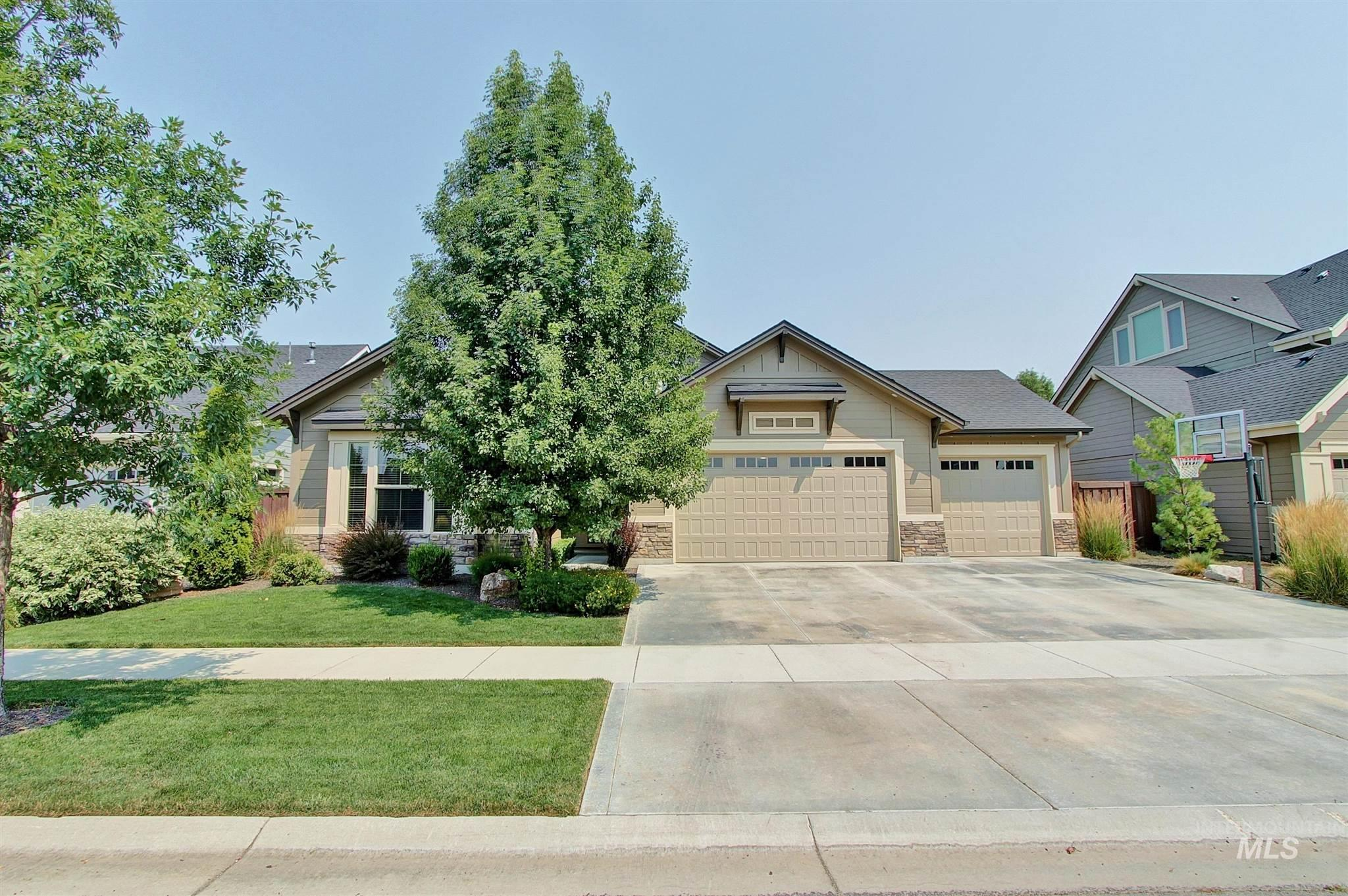 This beautiful Energy Star Certified single-level home w/bonus is sure to impress all who see it. Oak hardwood floors, high-end alder cabinets, & beautiful quartz slab countertops enhance the kitchen that features a new Bosch dishwasher, completing the stainless steel appliance package. An enlarged covered back patio is inviting after a long day while the oversized 3 car garage is perfect for all your toys or belongings. The community pool is within walking distance & the restaurants nearby will please you.