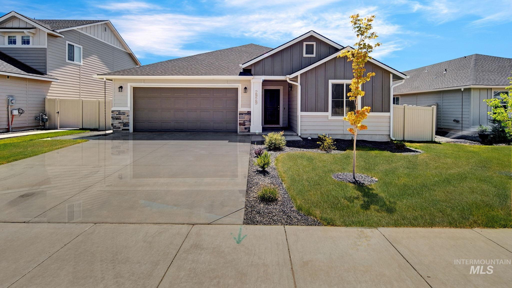 Why pay new construction prices? Better than new home features full sprinkler system, window coverings, enlarged rear patio + concrete walkway on east side of home.  Centrally located with large community park and playground for your personal enjoyment.  Split bedroom plan offers a generous sized, vaulted great room, large kitchen island, upgraded cabinets and abundant windows.  Beautiful wide plank vinyl flooring. Includes refrigerator, washer/dryer new in 2020 + ring doorbell.