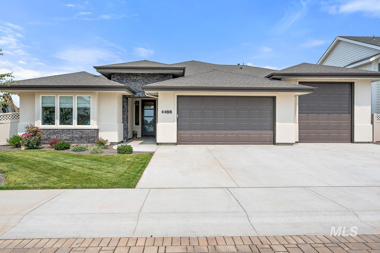 The amazing first impression starts with the designer road pavers in this family friendly neighborhood. The home impresses immediately with a grand 10ft entrance & open concept layout . Enjoy cooking with family in the bright stunning kitchen. Master en-suite won't disappoint either! Exit to the outdoor oasis w/ covered patio, raised garden beds & attached greenhouse. This home is better than new w/ office, custom window coverings and attention to detail in every space. Room for toys in the 3 car garage.