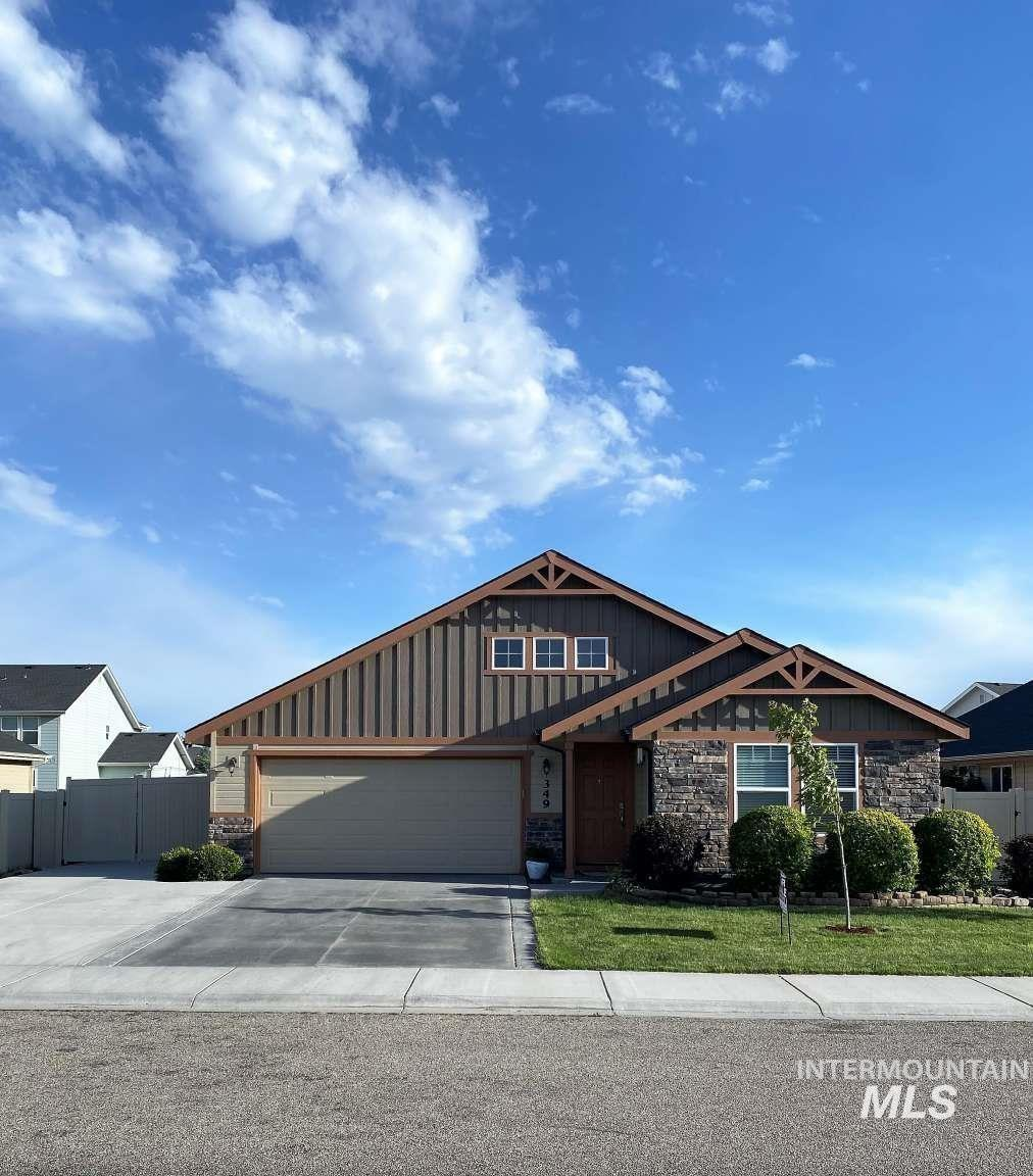 This beautiful home has open floor plan with large vaulted ceiling living room, kitchen & dining. This home features granite countertop in the kitchen. laminate floors, gas fireplace. master suite complete with dual vanities, tub & shower, & walk in closet.. Backyard has garden are with raised beds, fruit trees, fully landscaped and fenced, with large concrete patio. The garage has built in shelving with tons of storage. Driveway is extra wide, & plenty of room on side for RV parking.