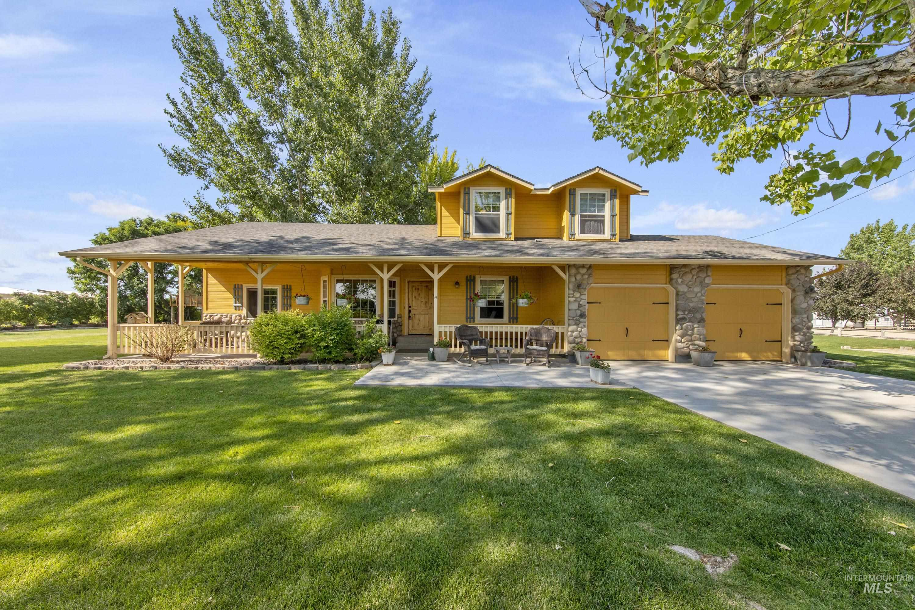 This 2183 ft updated home is situated on 10.3 irrigated acres on quiet dead end road with access to trail riding on public lands a 1/4 mile ride from the barns. 4bd, 2 1/2bth, open living room, open kitchen with beautiful granite kitchen countertops and farm sink. Lg Deck and Patio Includes 2 Outdoor Arenas, 26 rental stalls, 60' training pen, steel stock pens and wash stall. Mock saloon front highlights the gathering area with horse shoes and fire pit. Come enjoy the country! - Kami K Stock, Voice: 208-901-7579, Homie, Main: 520-940-0583, https://www.kamistock.com