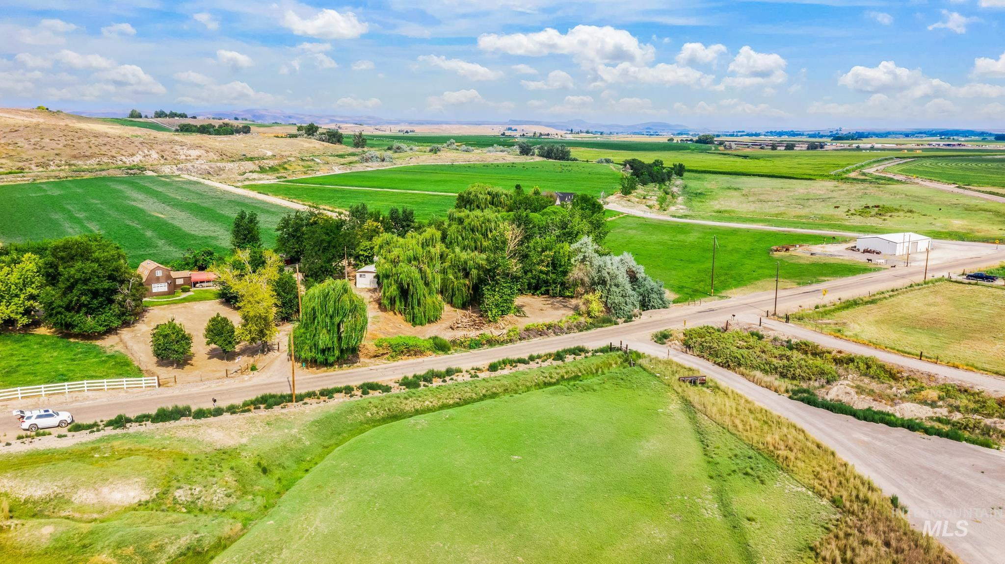 A perfect slice of country property, this ranchette on 2.74 acres is ideal for hobby farm, gardening, & horses. Beautiful setting along mature willow trees & foothills in the heart of Idaho's wine country. Property boasts irrigation rights, & no HOA or CCRs offering endless options. This light & bright 1220 square foot home offers a main level master, 2 living spaces, tall ceilings, cozy fireplace & hardwoods. Many outbuildings, oversized carport & a 800 square foot mobile home that could be re-connected to power & water for 2nd living quarters. Just minutes to the Snake River & boat ramp. - Sheila A Smith, Voice: 208-631-2248, RE/MAX Capital City, Main: 208-344-7477, http://www.SheilaSmithRealEstate.com
