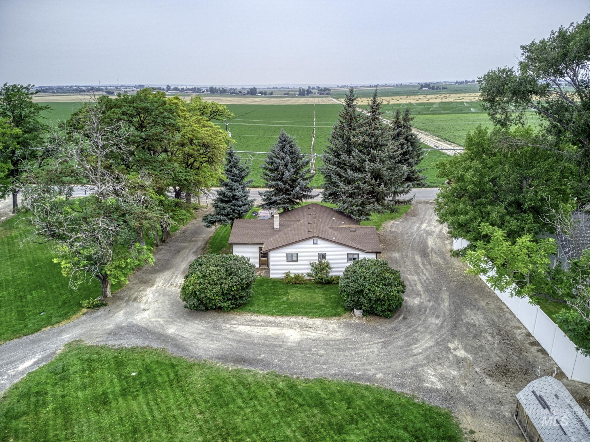 """HERE'S A WINNING OPPORTUNITY to purchase a """"Gold Medallion"""" FIXER-UPPER home with a newer 36 x 30 shop, gorgeous country views and NO CCR'S There is also an oversized bully barn on the property and room for pasture in front of the shop. The electrical is breakers, vinyl siding, newer roof, newer well, pressure tank, septic system, and auto sprinklers. HOME IS BEING SOLD """"AS IS"""" to settle an estate. Buyers to be responsible for all repairs. Cash or conventional financing will be required. - Cindy L Collins, Voice: 208-280-5336, Berkshire Hathaway HomeServices Idaho Homes & Properties, Main: 208-733-5336, https://www.thecollinsconnection.com"""