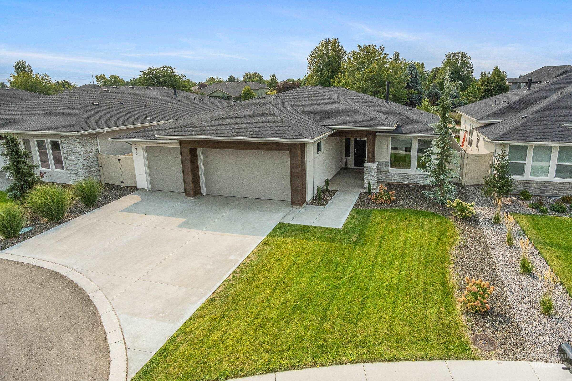 Stunning modern design in the highly sought after Movado estates Subdivision. 10 foot ceilings throughout, floor to ceiling fireplace, large quartz island and butler's pantry, spa-like master bath with huge soaker tub and separate walk in shower. Enjoy privacy on the large covered backyard patio which boarders the canal and has no direct back neighbors. Community pool. Includes custom window treatments, washer ,dryer, refrigerator, TV and wall mount in the great room, water softener and whole house water filtration system with extra filtered water at the kitchen sink, and a radon mitigation and fan installed earlier this year. - Renee Tiner, Main: 208-995-1981, Windermere Real Estate Professionals, Main: 208-343-5412,
