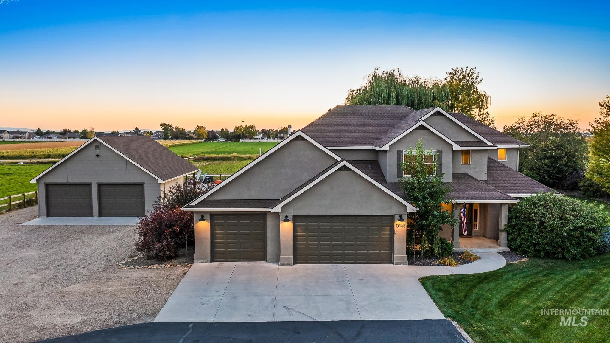 Bring your horses, pool toys, & semi- haulers! This country estate, sitting on a year round creek, features an in-ground pool w/powered, locking cover, irrigated horse pasture & tack room, 4 car garage w/ pass-through garage door & huge attic storage, plus a dream 4 car shop w/ power, a wood stove & evaporative cooler. Immaculately maintained throughout, with a flowing great room design w/wide plank LVP. Kitchen boasts stainless appliances, pantry & endless cabinets, formal & casual dining. Master offers dual vanities, soaker tub & separate walk-in shower. 2nd master features en-suite & all bedrooms have oversized walk-in closets. Professionally landscaped to create a private oasis w/water feature, pond & willow trees. Water softener & central vac are included. - Sheila A Smith, Voice: 208-631-2248, RE/MAX Capital City, Main: 208-344-7477, http://www.SheilaSmithRealEstate.com