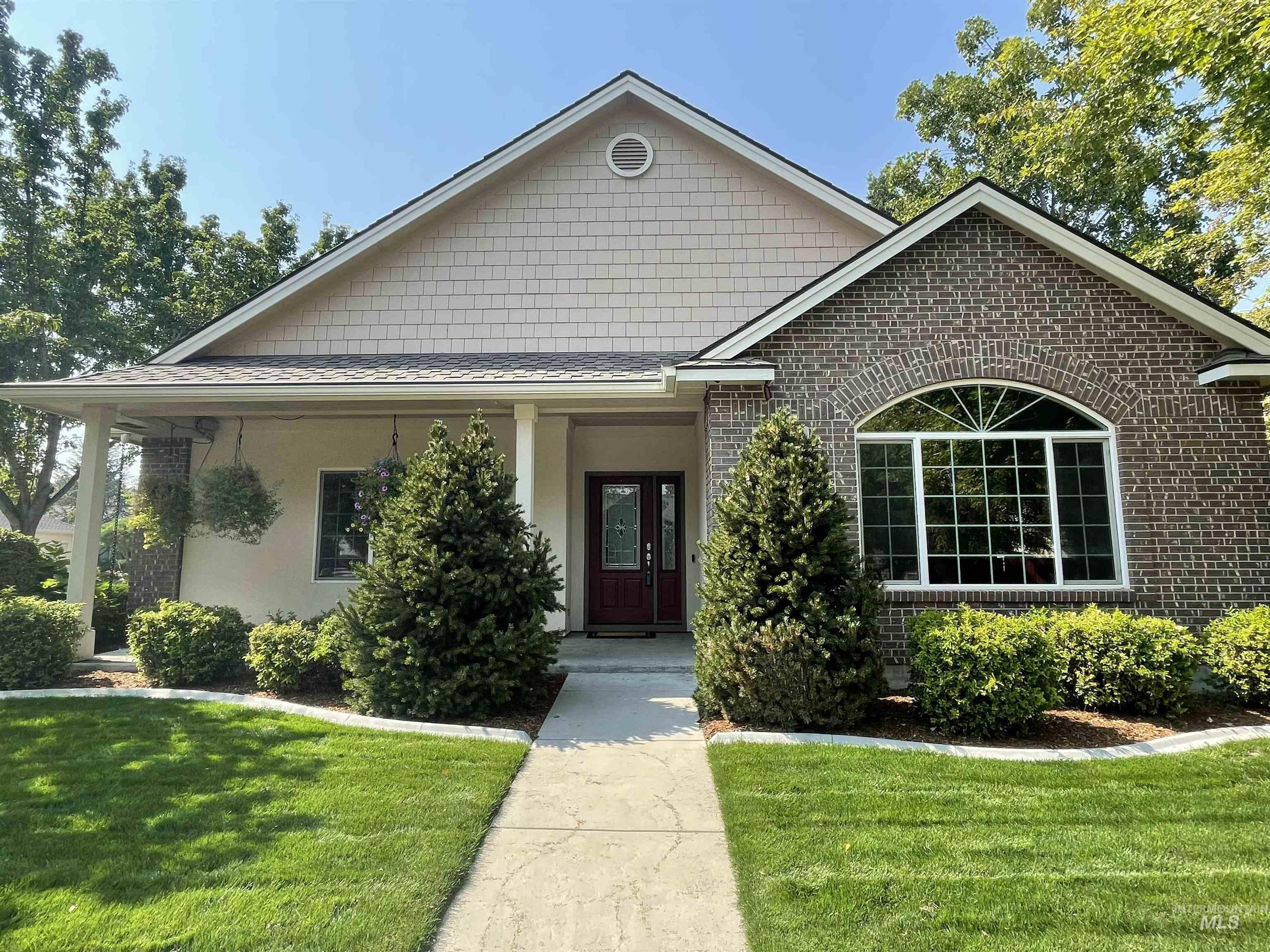 Beautiful 4 bedroom/3 bath home (could be 4 bedrooms and an office or 3 bedrooms, an office and a bonus room). Featuring hardwood floors, corian counter tops in the kitchen, and a formal dining room.  Open floor plan with gas fireplace. Large patio for outdoor entertaining with 2 Sun Setter awnings. Large master with walk in closet, Dual vanities, soaker tub and a Sun Valley Marble walk in shower, tile flooring. Dual zone heating and central vacuum. Mature beautiful landscaping on a nice corner lot, with a community irrigation system. Storage shed attached to the oversized 3 car garage. Epoxy flooring in garage. Beautiful neighborhood, walking distance YMCA, near The Village, shopping, parks and more!  Don't miss out on this home.  Call for your private showing today! Property has been well maintained and is being sold as is. - Michelle R Newell, Voice: 208-713-4571, Fathom Realty, Main: 208-576-4717, http://www.buyboisehomes.com