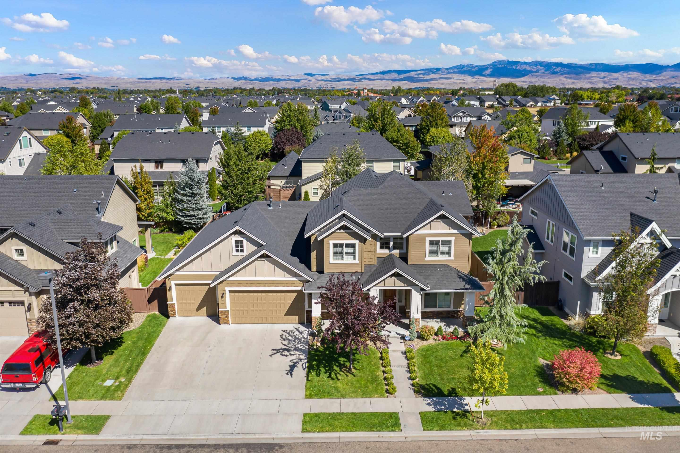 Welcome to your new home in Paramount Subdivision!! A premier master-planned community located in NW Meridian, Idaho, USA. Live in a neighborhood carefully designed to include education, recreation and retail amenities into the development. Club House with pools and walking trails steps away. 3,532 sq ft of pure living on almost ¼ of an acre! 5 Bed total with TWO principal bedrooms!! Beautiful finishes, craftsmanship & UPGRADES! TURN KEY READY this home features HARDWOOD FLOORS, walk-in closets in ALL bedrooms & lots of space for STORAGE! Office/Gym Room + Bonus Room + 4.5 Bathrooms + 4-Car Garage. Open concept kitchen, granite counters, brand new Water Softener, Gas Stove, Large Walk-In Pantry, Large Dining Area and Great Room w/Gas Fireplace. Two Outdoor Spaces in the Backyard and an Outdoor BASKETBALL COURT. The home exterior is newly painted and landscaping remodeled within the last year. NE facing backyard with large covered back patio. Elementary School in neighborhood! Near schools, shopping, & dining! - Denisse S Macias, Voice: 208-859-2714, Berkshire Hathaway HomeServices Silverhawk Realty Ada County, Main: 208-888-4128, https://denissemacias.com