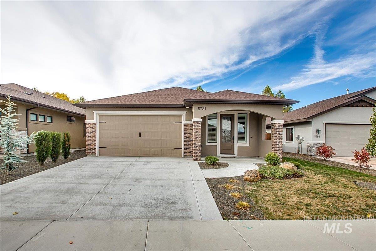 Welcome to the La Paloma model by Ted Mason in coveted LaMirada.  Better than new, LVP throughout living areas, custom shutters accent bronze windows and rich finishes throughout!  Huge great room with stone fireplace and custom built-ins, formal dining room with coffered ceiling, private covered patio and cozy front porch. Kitchen has modern flair with lots of counter space, custom cabinets, refrigerator included. Large master suite with walk-in tiled shower. Over sized garage for all of your needs + small shop area. Impressive community clubhouse and fitness center with pool and grand space for entertaining. Exterior landscaping maintenance included in affordable HOA.  HERS energy rated! Washer & dryer and water softener included!  This house is ready to go! - Dawn C Mitchell, Voice: 208-514-8800, Fathom Realty, Main: 208-576-4717,