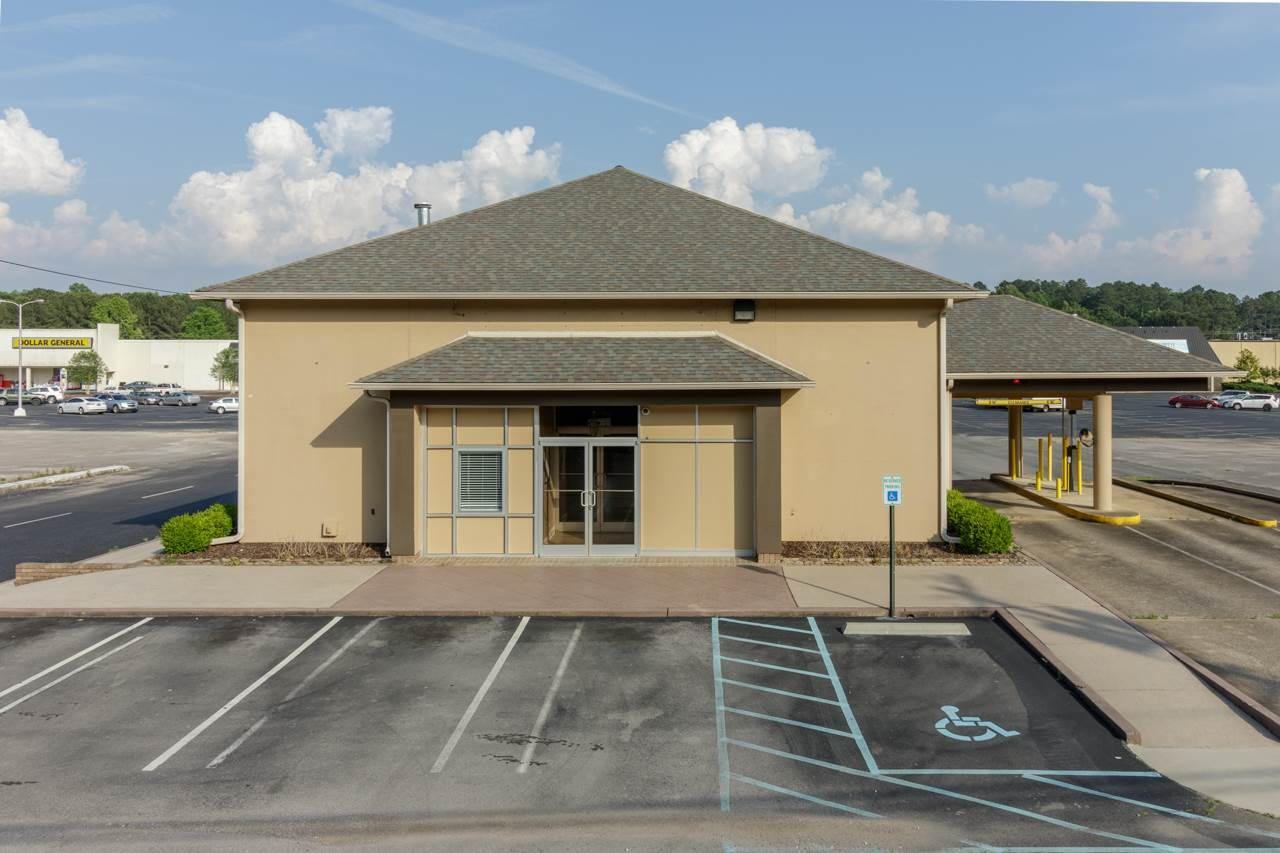 Former bank building on .20 acres with two drive through lanes Located on Hwy. 279 in Scottsboro Alabama This property features 3 offices, front lobby, file room and safe and safe deposit boxes. Daily traffic counts at 9,890 vehicles per day.